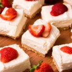 No Bake Cheesecake Bars with strawberry garnish
