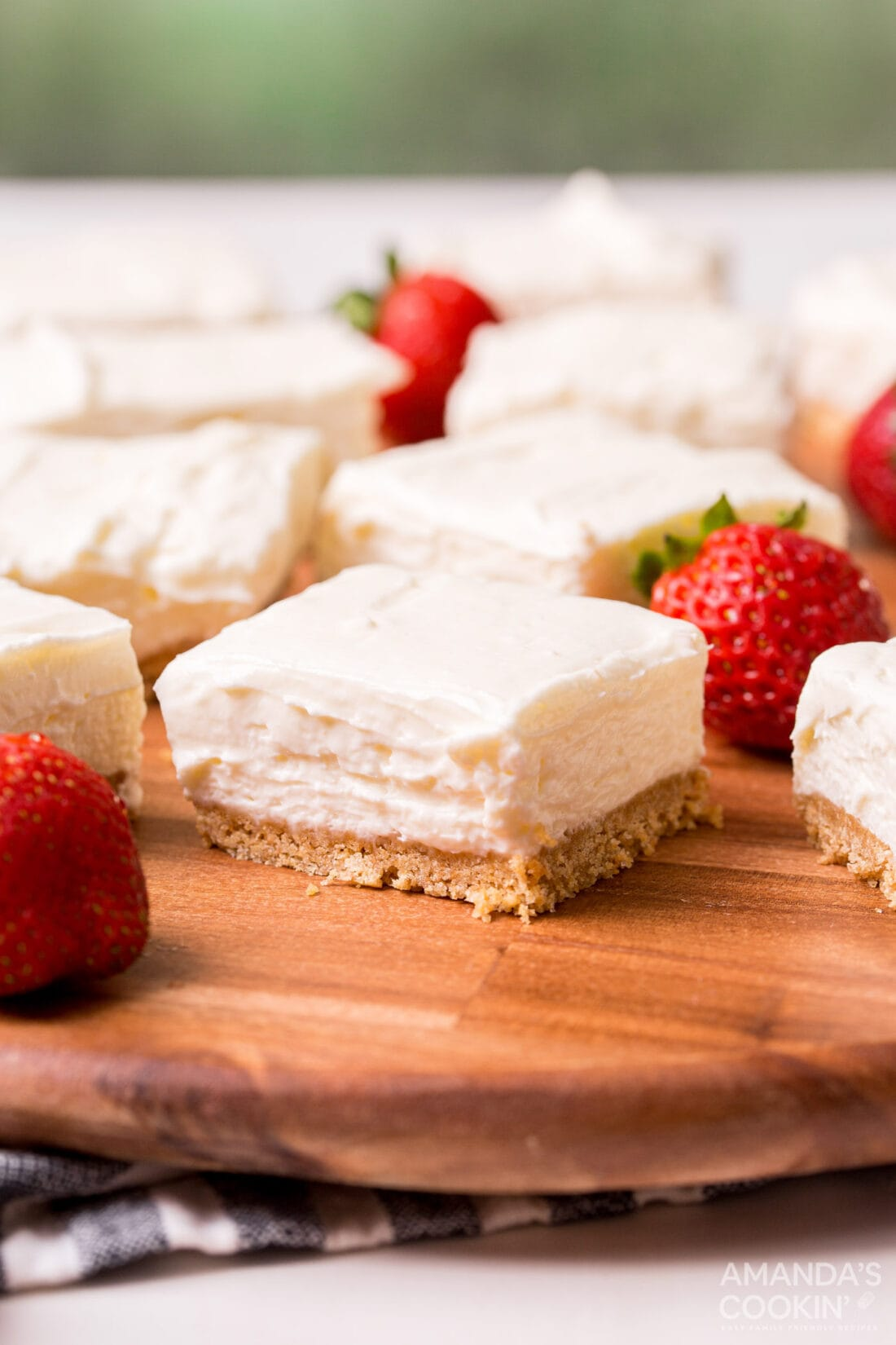 No Bake Cheesecake Bars on a cutting board