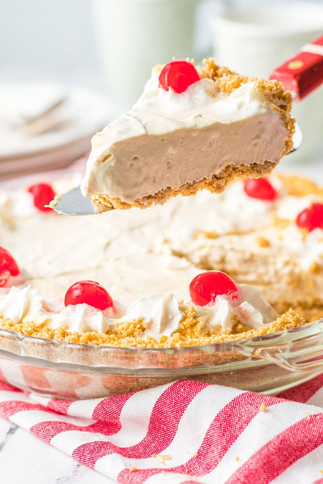 lifting a slice of Root Beer Float Pie
