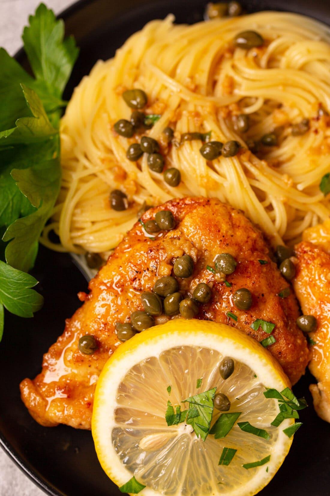 close up of Chicken Piccata with spaghetti